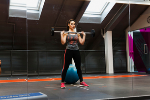 Sweden, Young woman exercising at gymの写真素材 [FYI02204855]