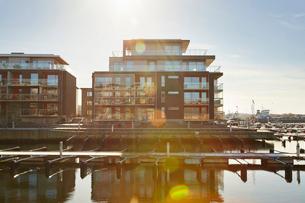 Sweden, Vastra Gotaland, Fiskeback, Modern houses at marinaの写真素材 [FYI02204907]
