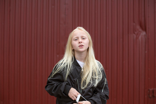 Sweden, Portrait of girl (12-13) holding mobile phoneの写真素材 [FYI02205019]