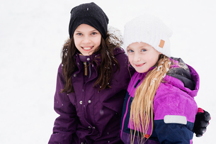 Sweden, Vastmanland, Portrait of girls (10-11) in warm clothingの写真素材 [FYI02205090]