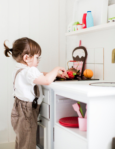 Sweden, Small girl (2-3) playing cookingの写真素材 [FYI02205128]