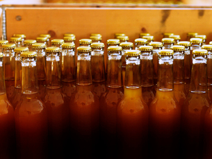 Sweden, Unlabelled bottles with closed tops and filled with light brown liquidの写真素材 [FYI02205147]