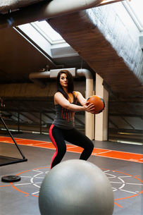 Sweden, Young woman exercising at gymの写真素材 [FYI02205252]