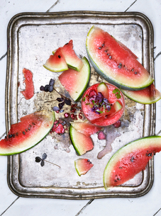 Sweden, Overhead view cocktail and slices of watermelon on silver trayの写真素材 [FYI02205374]