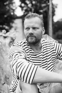 Sweden, Gotland, portrait of mature man in striped shirtの写真素材 [FYI02205479]