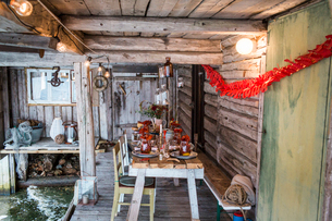 Sweden, Patio with fresh crayfish on wooden table at crayfish partyの写真素材 [FYI02205551]