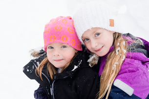 Sweden, Vastmanland, Portrait of girls (6-7, 10-11) in warm clothingの写真素材 [FYI02205622]