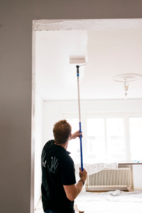Sweden, Man painting ceilingの写真素材 [FYI02205864]