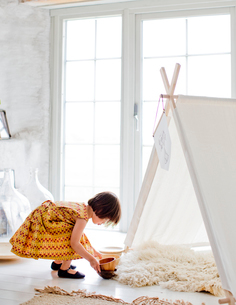 Sweden, Girl (4-5) playing next to tent at homeの写真素材 [FYI02205969]