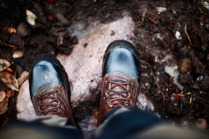Sweden, Man in shiny boots standingの写真素材 [FYI02206036]