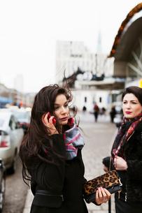 Sweden, Stockholm, Woman talking on phoneの写真素材 [FYI02206044]
