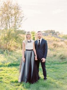 Sweden, Groom and bride standing together holding handsの写真素材 [FYI02206172]
