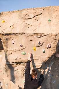 Sweden, Skane, Malmo, Man climbing on climbing wallの写真素材 [FYI02206212]