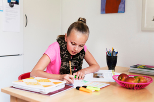 Sweden, Girl (10-11) sitting and studyingの写真素材 [FYI02206295]