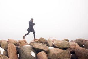 Sweden, Skane, Malmo, Man walking on stonesの写真素材 [FYI02206357]