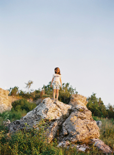 Sweden, Gotland, Visby, Boy (8-9) standing on rock and looking at viewの写真素材 [FYI02206408]