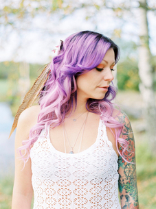 Sweden, Bride with long purple hair and tattoo at hippie weddingの写真素材 [FYI02206533]