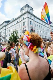 Sweden, Uppland, Stockholm, Vasagatan, Redhead woman at gay pride paradeの写真素材 [FYI02206584]