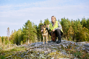 Sweden, Uppland, Rison, Portrait of volunteer with dog helping emergency services find missing peoplの写真素材 [FYI02206609]