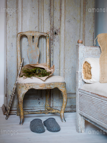 Sweden, Rustic chair, flute, slippers and pine branchesの写真素材 [FYI02206722]