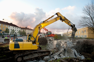 Sweden, Vastra Gotaland, Bulldozer by ruined building in streetの写真素材 [FYI02206753]