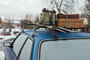 Sweden, Blue car with suitcase and ski-boots on topの写真素材 [FYI02206834]