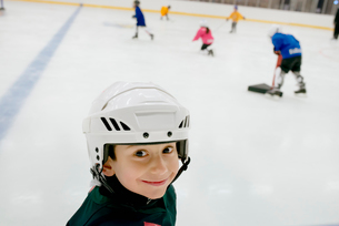 Sweden, Portrait of young male hockey player (4-5) on iceの写真素材 [FYI02207040]