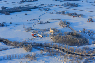 Church by snow covered fields in Narke, Swedenの写真素材 [FYI02207536]