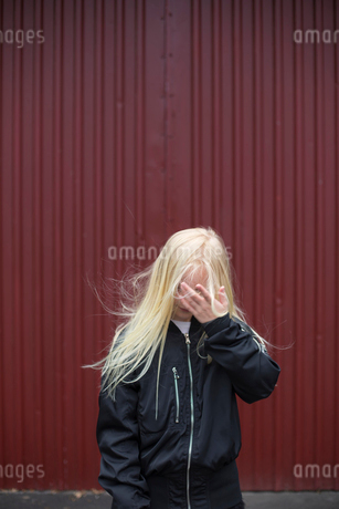 Sweden, Girl (12-13) with head in handsの写真素材 [FYI02207590]
