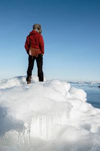 Man on ice in Biludden, Swedenの写真素材 [FYI02207723]