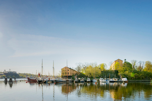 Sweden, Stockholm, Skeppsholmen, Boats in harborの写真素材 [FYI02207744]