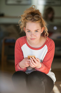Sweden, Teenage girl (14-15) looking at camera with confidenceの写真素材 [FYI02207821]
