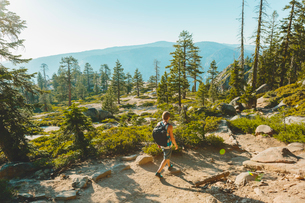USA, California, Yosemite National Park, Man hiking at Taft Point Trailの写真素材 [FYI02208331]