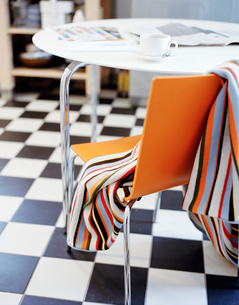 Striped blanket on chair in kitchenの写真素材 [FYI02208334]