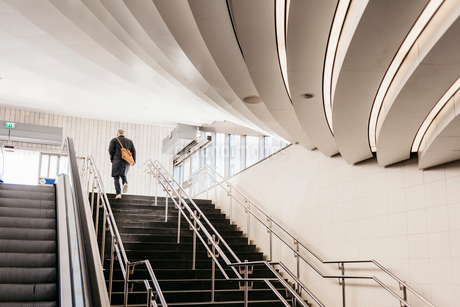 Man walking up staircase of modern building in Stockholm, Swedenの写真素材 [FYI02208717]