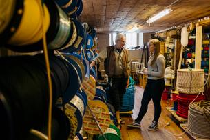 Rope maker talking to his teenage apprentice in his shopの写真素材 [FYI02208793]