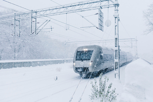 Train during snow in Stockholmの写真素材 [FYI02209133]