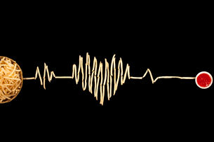 Creative electrocardiogram made of potato chips and ketchupの写真素材 [FYI02209844]