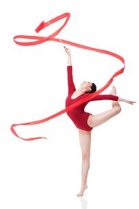 Female gymnast performing rhythmic gymnastics with ribbonの写真素材 [FYI02210393]