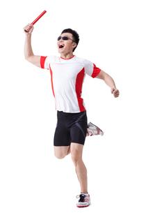 Male athlete running with relay batonの写真素材 [FYI02210398]
