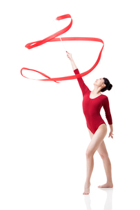 Female gymnast performing rhythmic gymnastics with ribbonの写真素材 [FYI02210562]