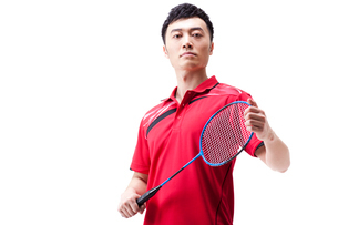 Male athlete with badminton racketの写真素材 [FYI02210588]