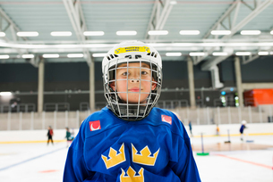 Sweden, Portrait of young male hockey player (8-9) on iceの写真素材 [FYI02210839]
