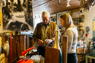 Rope maker talking to his teenage apprentice in his shopの写真素材 [FYI02210972]