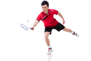 Male athlete playing badmintonの写真素材 [FYI02211123]