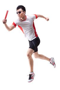 Male athlete running with relay batonの写真素材 [FYI02211175]