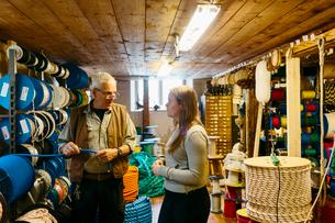 Rope maker talking to his teenage apprentice in his shopの写真素材 [FYI02211200]