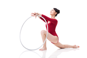 Female rhythmic gymnast performing with hoopの写真素材 [FYI02211240]