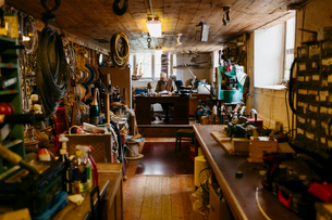 Rope maker sitting at desk in his shopの写真素材 [FYI02211609]