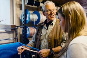 Rope maker talking to his teenage apprentice in his shopの写真素材 [FYI02211643]